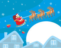 The santa claus flying with the sack full of presents Royalty Free Stock Image