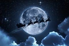 Santa Claus Flying On The Sky Fotografering för Bildbyråer