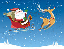 Santa Claus flying in sleigh on Christmas Eve. Santa Claus and toy bag in sleigh being pulled through a winter night scene by a reindeer Stock Photos