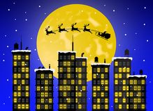 Santa Claus flying with the sleigh and the reindeer over the city buildings royalty free illustration