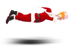 Santa claus flying to deliver a gift box Royalty Free Stock Images