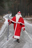Santa Claus on forest road 1. Santa Claus coming along deep forest road Stock Images