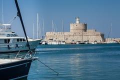 Santa Claus Fortress på pir i den Mandraki hamnen Royaltyfri Fotografi