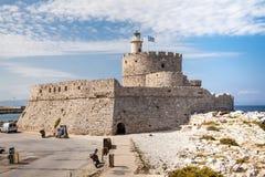 Santa Claus Fortress på pir i den Mandraki hamnen Fotografering för Bildbyråer