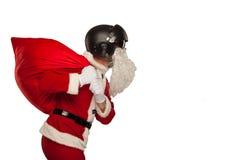 Santa Claus fraîche avec un sac des cadeaux dans des jets Photographie stock libre de droits