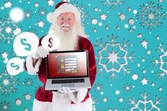 Santa Claus framlägger en bärbar dator Royaltyfri Bild