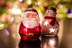 Santa Claus and Frosty ornaments on blurred background Stock Image