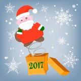 Santa Claus fuera de la caja con enhorabuena de una sorpresa Fotografía de archivo