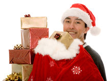 Santa claus full of gifts Royalty Free Stock Image