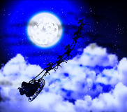 Santa Claus at the full moon in the cloudy night sky Royalty Free Stock Photography