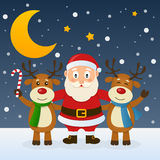 Santa Claus with Funny Reindeer. Happy cartoon Santa Claus character with two funny reindeer, in a snowy scene with the moon. Eps file available stock illustration