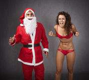 Santa claus with a furious woman Royalty Free Stock Photography