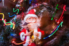 Santa Claus with garland. Santa Claus and christmas lights stock images