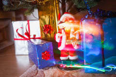 Santa Claus with garland. Santa Claus and christmas lights, gift package and little bit of magic stock photography