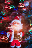 Santa Claus with garland. Santa Claus and christmas lights and little bit of magic royalty free stock images