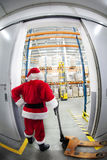 Santa Claus & the gate to gift distribution center Royalty Free Stock Images