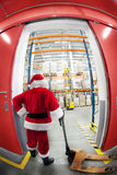 Santa Claus & the gate to gift distribution center Royalty Free Stock Photo