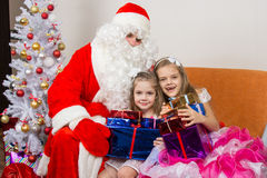 Santa Claus gave presents to children and hugged Stock Photo