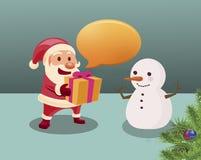Santa Claus geeft een gift voor sneeuwman Royalty-vrije Stock Foto's
