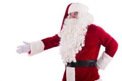 Santa Claus ger hans hand Arkivfoto