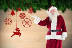 Santa claus gesturing against digitally generated background Royalty Free Stock Photo