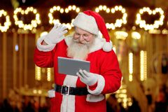 Santa Claus gesturing with pc tablet. Royalty Free Stock Photography
