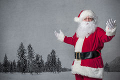 Santa Claus gesturing. Santa Claus welcomes with spread arms Stock Photos