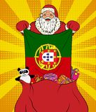 Santa Claus gets national flag of Portugal out of the bag with toys in pop art style. Illustration of new year in pop art style. On yellow background stock image