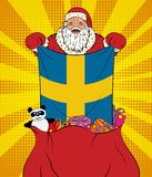 Santa Claus gets national flag of Sweden out of the bag with toys in pop art style. Illustration of new year in pop art style royalty free illustration