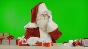 Santa Claus is Getting a Call on his Cell Phone - Bad News stock video footage