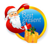 Santa Claus with a gift Stock Photography