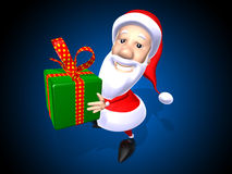Santa Claus with a gift stock photo