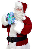 Santa Claus with a gift Stock Photos