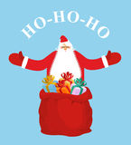 Santa Claus and gift bag. HO-HO-HO. Stock Photos