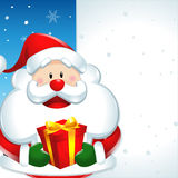 Santa claus with gift, and big sign in christmas Stock Photography