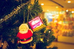 Santa Claus with Gift Box on Christmas Tree.  Stock Images