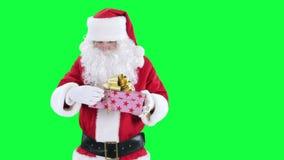 Santa Claus with a gift box chroma key (green screen) stock video
