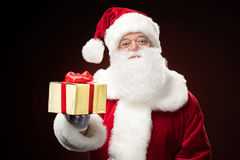Santa Claus with gift box in hand Stock Image