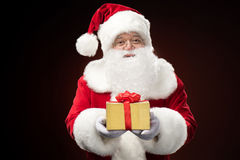 Santa Claus with gift box in hand Royalty Free Stock Image