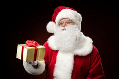Santa Claus with gift box in hand Royalty Free Stock Photo