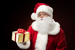 Santa Claus with gift box in hand Stock Images