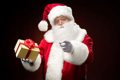 Santa Claus with gift box in hand Royalty Free Stock Images