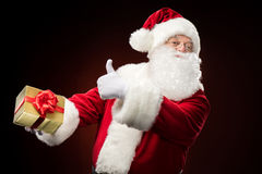 Santa Claus with gift box in hand Royalty Free Stock Photos