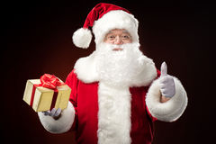 Santa Claus with gift box in hand Stock Photo
