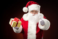 Santa Claus with gift box in hand Royalty Free Stock Photography