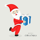 Santa Claus with gift box for Merry Christmas celebration. Stock Image
