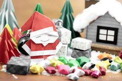 Santa claus and gift box with small star paper on the snow field Stock Image