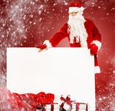 Santa Claus with gift boxes Stock Image