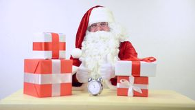 Santa Claus with gift boxes stock footage
