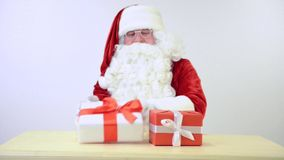 Santa Claus with gift boxes stock video